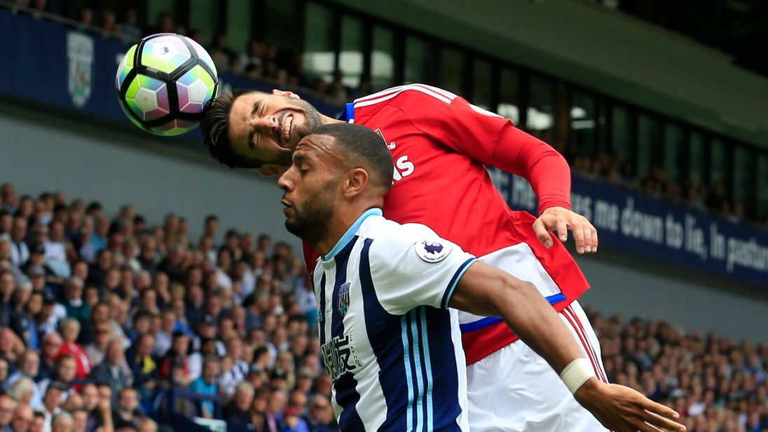 Antonio Barragan (up) wins a header from Matty Phillips during the West Brom v Middlesbrough match in the Premier League