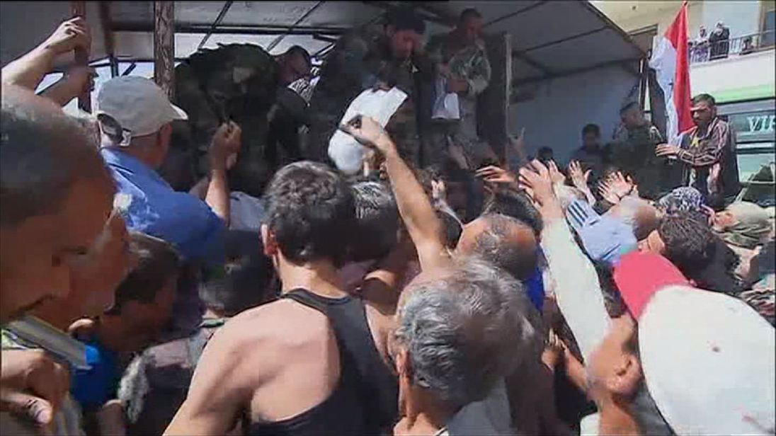 Russian TV broadcast images of aid being handed out on the outskirts of Aleppo
