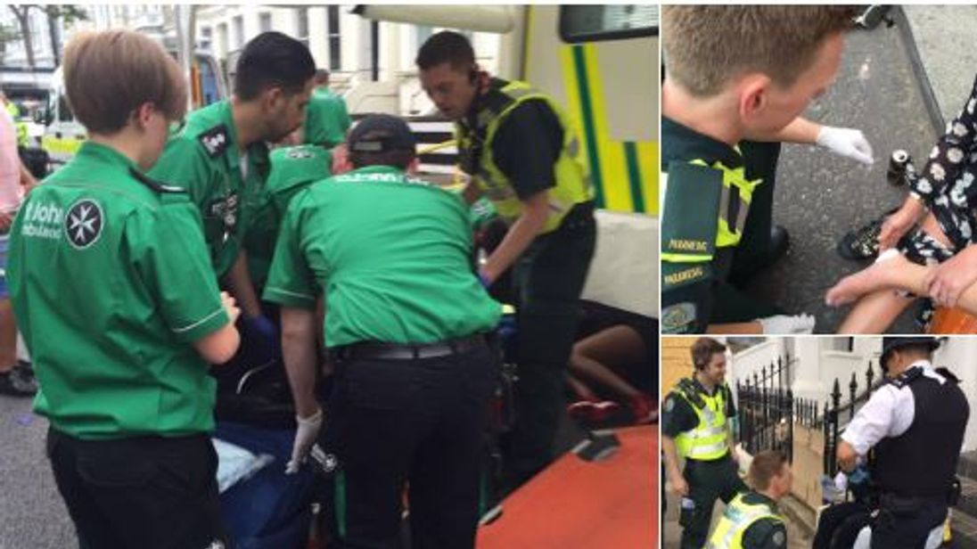 Paramedics treat some of the injured at the Notting Hill Carnival event