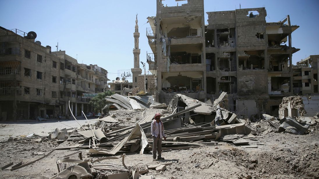 The damage after an airstrike in a rebel-held part of Damascus on Monday