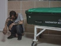 A man mourns next to the coffin of a victim of the Gaziantep wedding bombing