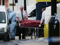 A body is removed from the scene in Russell Square, central London, after a knife attack