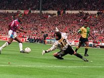 Former Aston Villa footballer Dalian Atkinson scoring the first goal in the Coca Cola Cup Final at Wembley against Manchester United goalkeeper Les Sealey