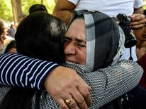 Women mourn at the funeral for a victim of a wedding bombing in Gaziantep