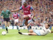 Aston Villa's Dalian Atkinson evades a tackle from Ray Ranson of Manchester City