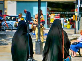 Two Muslim women in burkas walking in Bristol