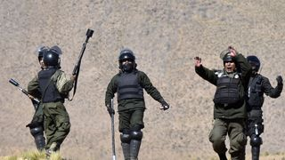 Riot police clash with miners in Bolivia after protests over workers' rights turned violent
