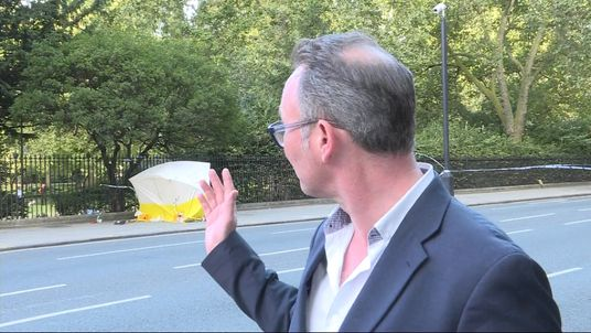 Sky's Mark White speaks to a witness after a knife attack in central London.