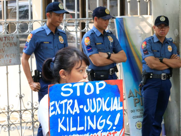 Protests against the killings have been held outside the country's Department of Justice