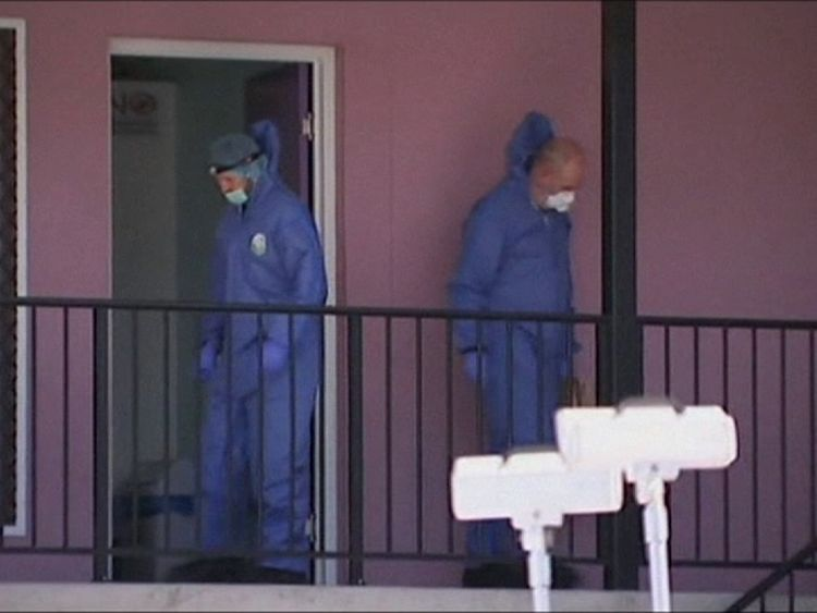 Forenisc officers at the scene of the stabbing