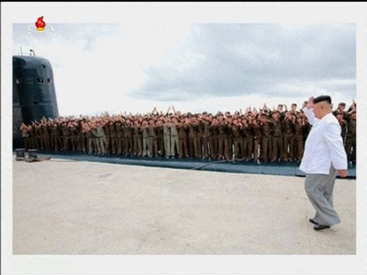 Kim Jong-Un congratulates the crew