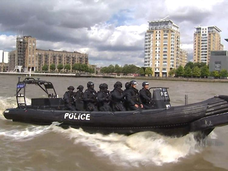A Metropolitan Police boat containing anti-terrorism officers patrols the River Thames.
