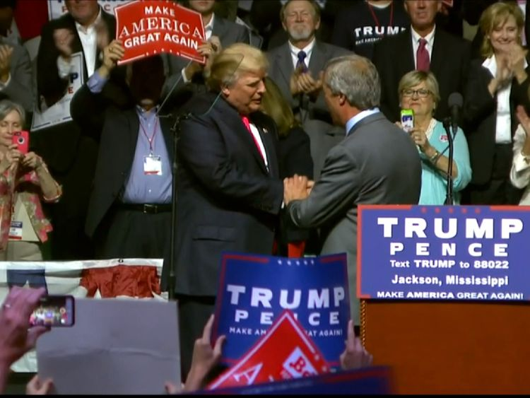 Mr Trump shakes hands with Mr Farage after his speech