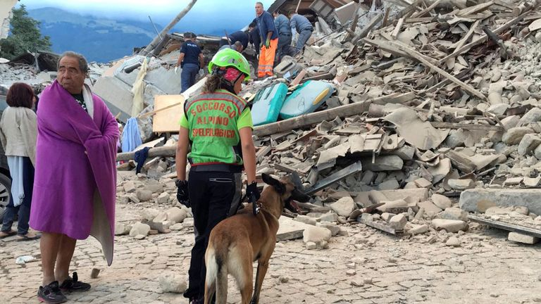 Rescuers assess the damage in earthquake-hit Amatrice