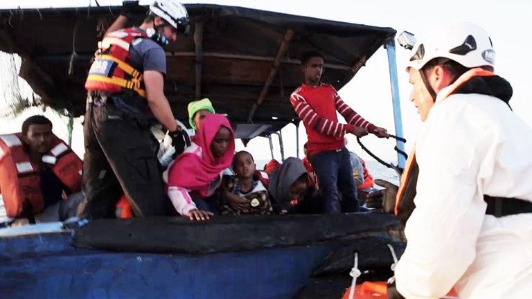 Eritrean refugees are rescued from a rickety boat by Italian coastguard