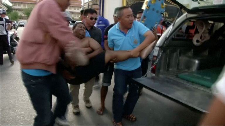 An injured man is rushed for treatment