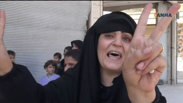 A resident celebrates the liberation of Syria's Manbij from Islamic State