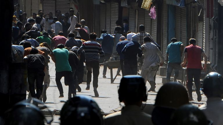 Kashmiri Muslims run from Indian forces firing at them with pellet guns, earlier this month
