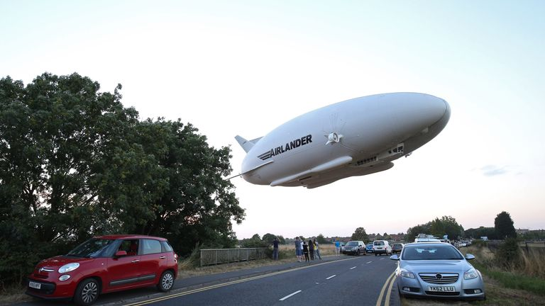 The Airlander 10 is seen over a road on its first flight