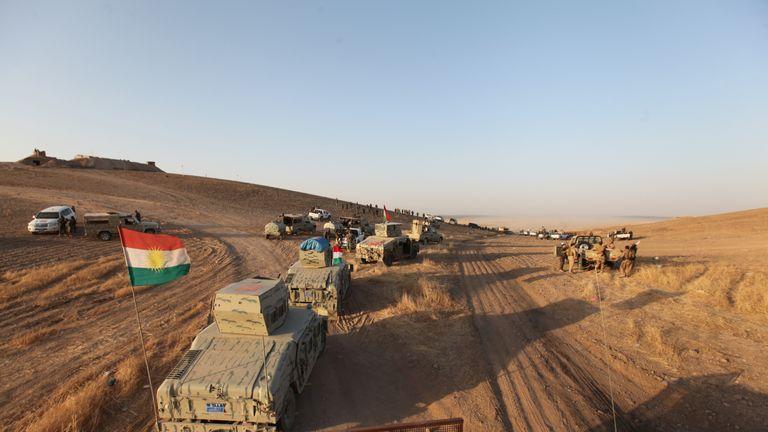 Military vehicles of the Kurdish Peshmerga forces southeast of Mosul, Iraq