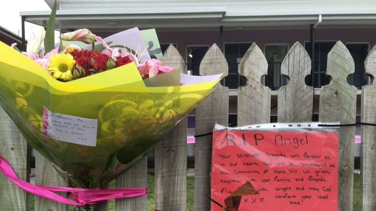 Flowers left at the backpacker hostel where the killing took place