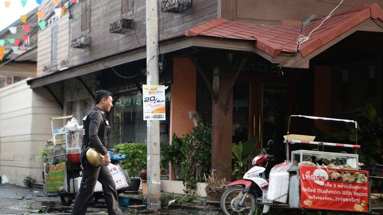 Investigators at the scene of one of the attacks