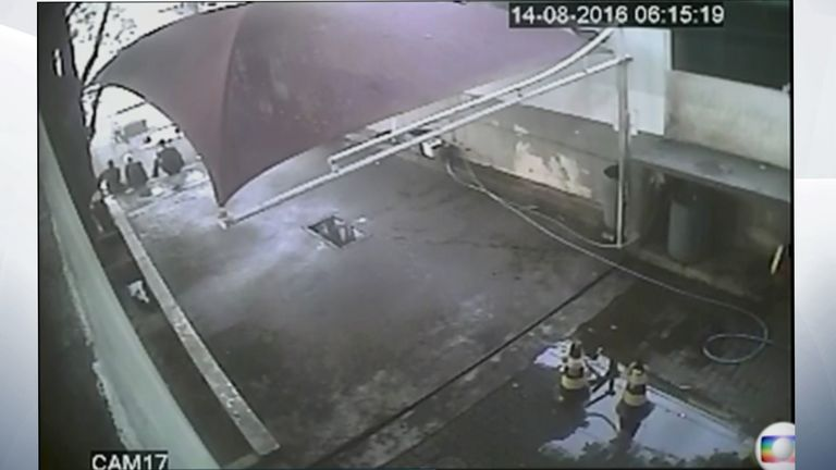 Video allegedly showing the swimmers sat by the station. Pic: Globo TV
