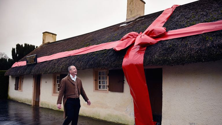 ALLOWAY, SCOTLAND - JANUARY 23: Stuart Cochrane from the Burns Birthplace Museum walks past the birthplace of Robert Burns on January 23, 2015 in Alloway, Scotland.