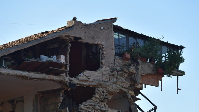 A building is severely damaged after being struck by an earthquake in Amatrice