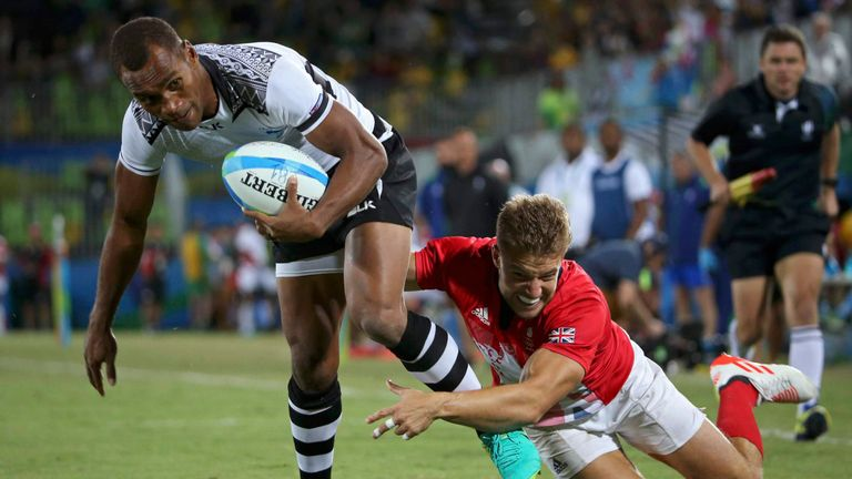 Osea Kolinisau of Fiji evades Team GB's Tom Mitchell to score a try