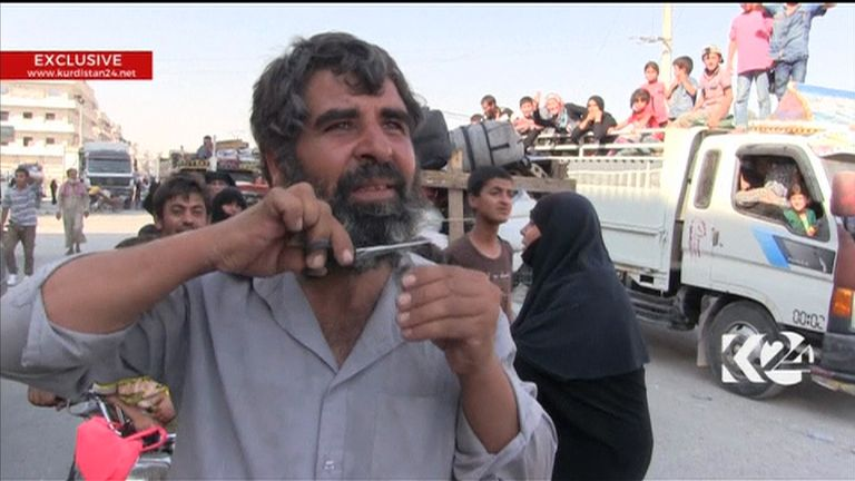 Manbij resident cuts his beard after the city is liberated from Islamic State