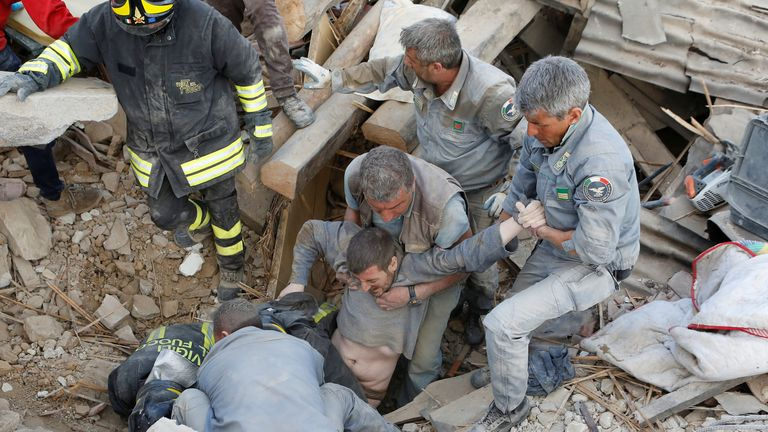 A man is pulled alive from the rubble in Amatrice