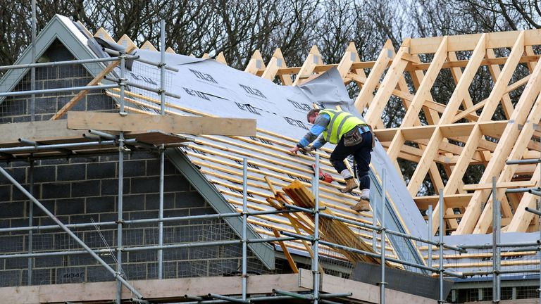 A roof worker building new houses. File picture
