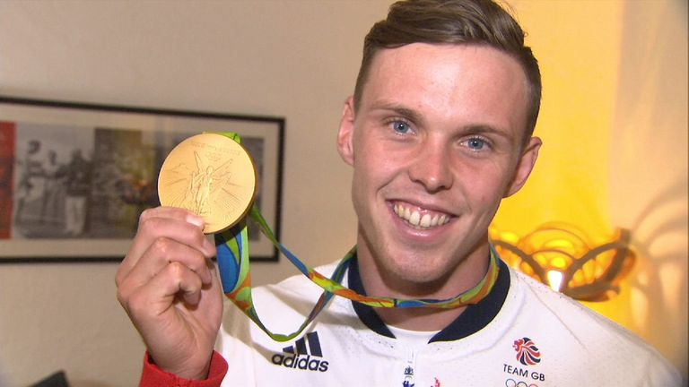 Joe Clarke shows off his Olympic gold medal