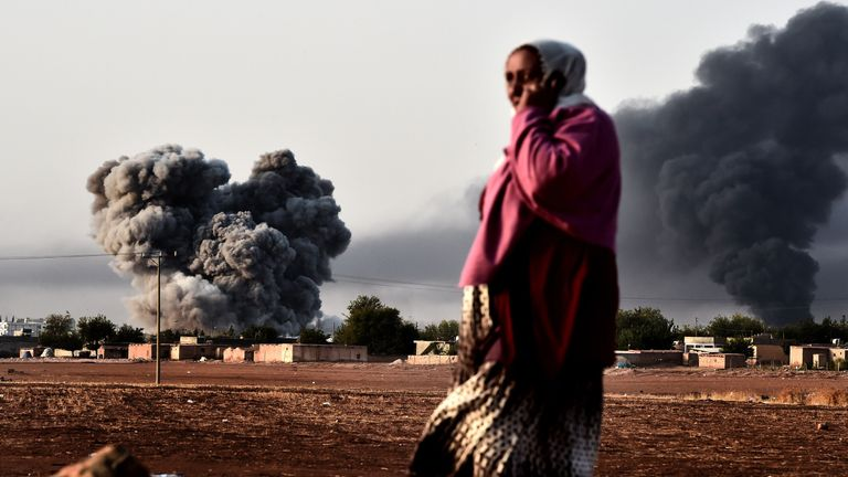 Smoke rises after an air strike from the US-led coalition on the Syrian town of Kobani in October 2014