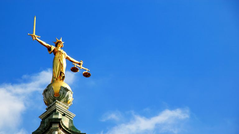 The Scales of Justice on top of  the Old Bailey court in central London