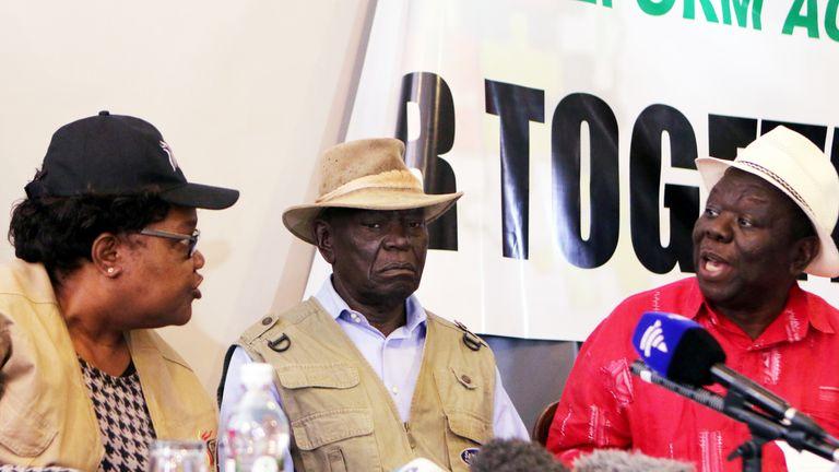 Joice Mujuru (L), Morgan Tsvangirai (R) and  Dydimus Mutasa (C)