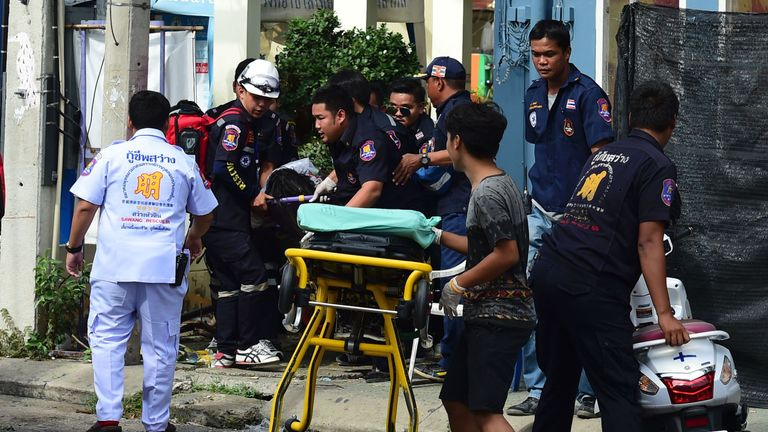 Emergency workers treat the injured