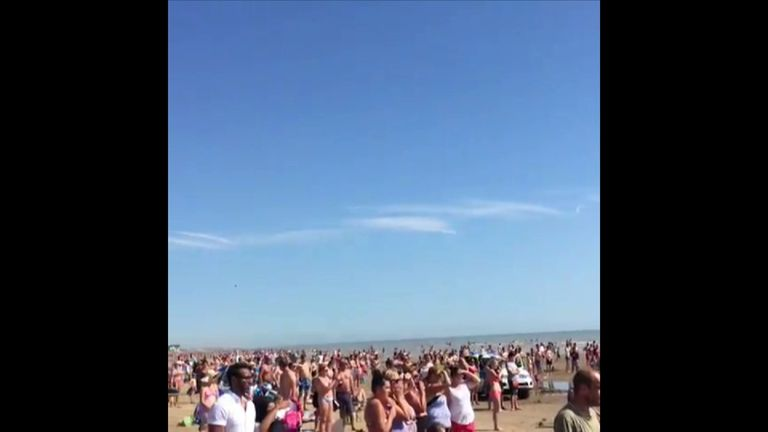 Beachgoers watch as the tragedy unfolds on Camber Sands
