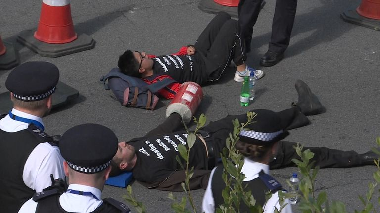 Black Lives Matter protesters lying on the road heading into Heathrow aiport