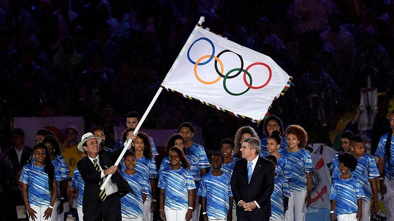 The Olympic flag is handed over from Rio at the closing ceremony