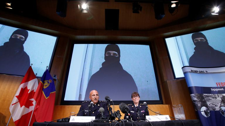 An image said to be of Aaron Driver, a Canadian man killed by police on Wednesday, is projected on screens during a news conference with Royal Canadian Mounted Police