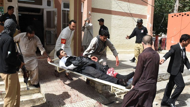 Volunteers use a stretcher to move an injured lawyer outside the hospital