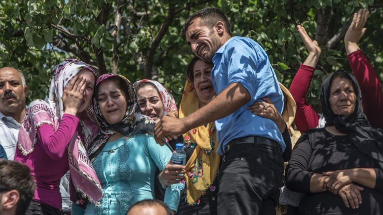 Mourners at the funeral of a victim of the Gaziantep wedding bomb