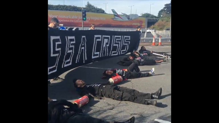 Protestors lie on the road blocking traffic getting to Heathrow airport