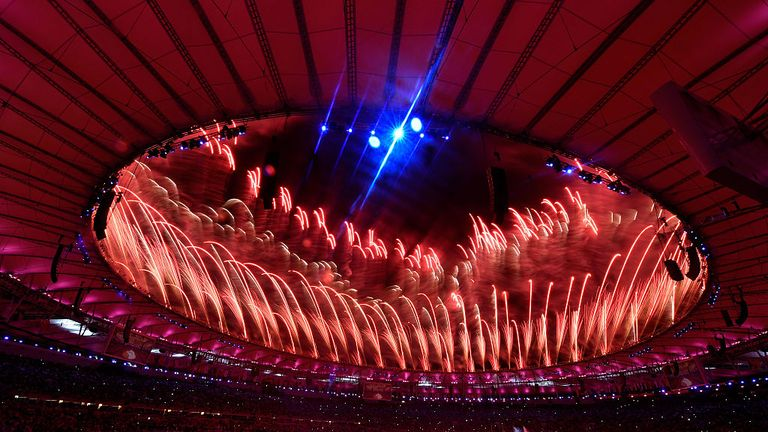 The Maracana is enveloped in red fireworks during the Olympic closing ceremony