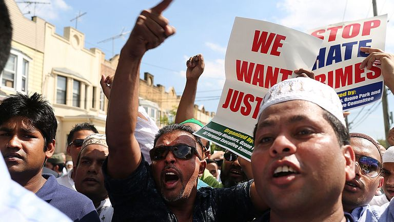 Angry protesters marched to the scene of the murders after the service