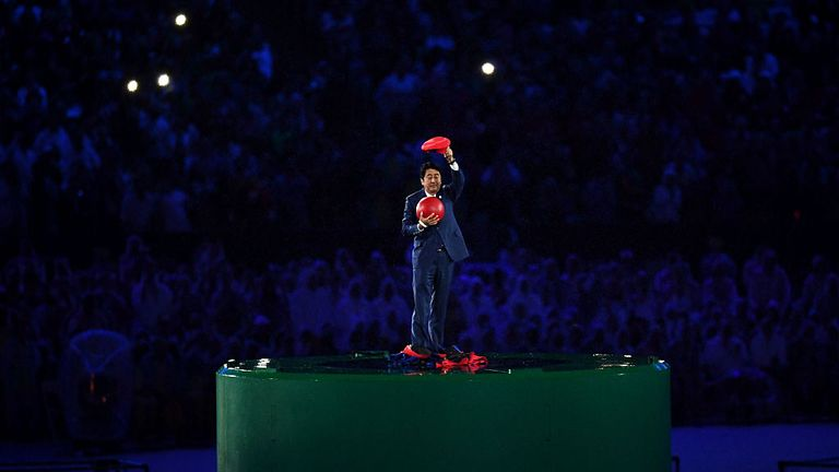 Shinzo Abe dressed as video game character Mario at the Olympic closing ceremony