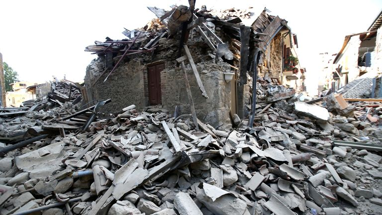 A collapsed house following an earthquake in Amatrice, central Italy