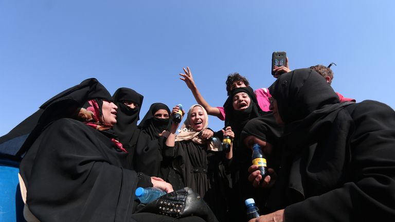 Civilians react after they were evacuated by the Syria Democratic Forces (SDF) fighters from an Islamic State-controlled neighbourhood of Manbij, in Aleppo Governorate, Syria